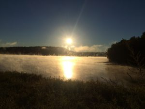 Sunrise with steam rising from the nearby cove on the Penobscot.
